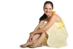 Girl in yellow dress. Sits on a floor royalty free stock photo