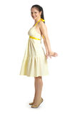 Girl in yellow dress. On a white background royalty free stock photo