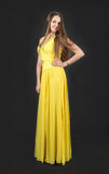 Girl in a yellow dress Royalty Free Stock Images