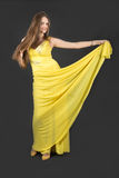 Girl in a yellow dress Royalty Free Stock Photo