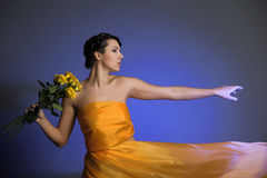 Girl in yellow dress flying Stock Images