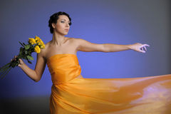 Girl in yellow dress flying Royalty Free Stock Photography