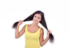 Girl in a yellow dress holding her hair Stock Photo