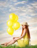 Girl in yellow dress with red hair Stock Photography