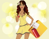 Girl with yellow dress shopping. The background is yellow. Royalty Free Stock Photography