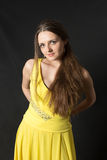 Girl in a yellow dress Royalty Free Stock Photography