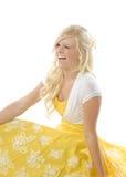 Girl in yellow dress winking Stock Photo