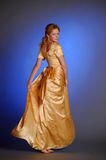 Girl in yellow evening long dress Royalty Free Stock Image