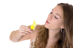 Girl with a yellow feather Royalty Free Stock Photo