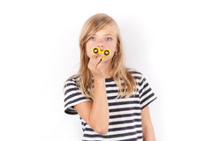 Girl with yellow fidget spinner. Isolated on white Stock Images