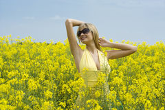 Girl in yellow field Royalty Free Stock Images