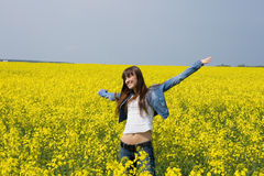 Girl in yellow field. Happy young pretty woman outdoor Royalty Free Stock Photos