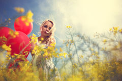 Girl in yellow field over sunny day Royalty Free Stock Image