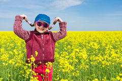 Girl in yellow field of rape Stock Images