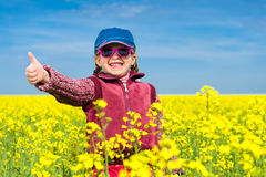 Girl in yellow field of rape Royalty Free Stock Photo