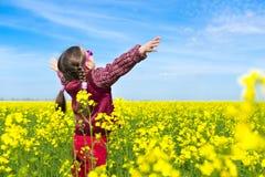 Girl in yellow field of rape Stock Photo