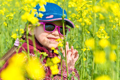 Girl in yellow field of rape Royalty Free Stock Images