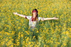 Girl in the yellow field. Stock Photography