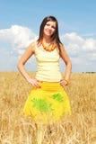 Girl in a yellow field of wheat. Beautiful girl in a yellow field of wheat royalty free stock photos