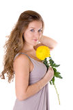 Girl with a yellow flower Stock Photo