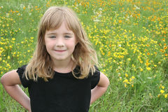 Girl in Yellow Flower Field Stock Image