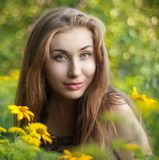 Girl with yellow flowers Stock Images