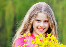 The girl with a yellow flowers Royalty Free Stock Photo
