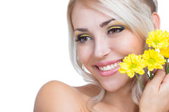 Girl with yellow flowers Stock Photos