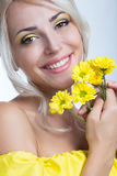 Girl with yellow flowers Royalty Free Stock Photos