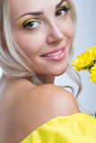 Girl with yellow flowers Royalty Free Stock Photography