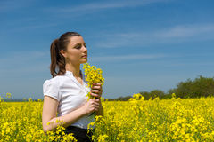 Girl with yellow flowers in the field Royalty Free Stock Photos