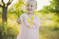 Girl with yellow flowers Stock Photography