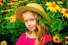Girl in yellow flowers Stock Photos
