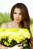 Girl with yellow flowers smiling Royalty Free Stock Images
