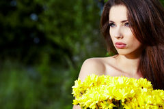 Girl with yellow flowers smiling Stock Photo
