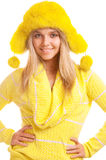Girl in yellow fur cap and sweater Royalty Free Stock Photo