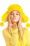Girl in yellow fur cap and sweater Stock Images