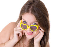Girl in yellow glasses Royalty Free Stock Images