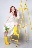 Girl in yellow gumbooots Stock Image