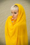 Girl in a yellow handkerchief Royalty Free Stock Photo