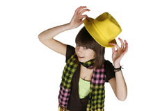 Girl in yellow hat. Beautiful young girl in yellow hat with a astonish expression, isolated on white stock images