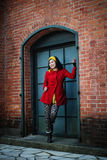Red Coat and Glass Door Stock Photo
