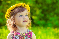Girl with yellow headwreath on Royalty Free Stock Photos