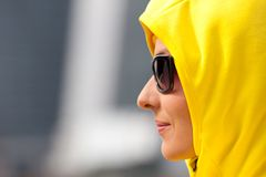 Girl in a yellow hood. Profile girl in a yellow hood with copy-space Royalty Free Stock Image