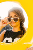 Girl with yellow inflatable ring. Stock Photo