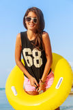 Girl with yellow inflatable ring. Stock Photography