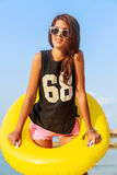 Girl with yellow inflatable ring. Stock Photos