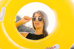 Girl with yellow inflatable ring. Royalty Free Stock Photos