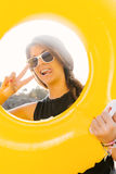 Girl with yellow inflatable ring. Royalty Free Stock Photography