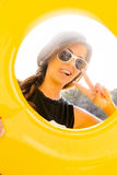 Girl with yellow inflatable ring. Stock Image